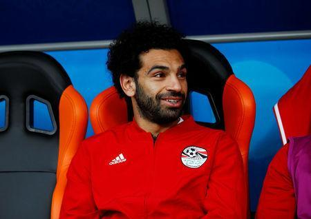 Soccer Football - World Cup - Group A - Egypt vs Uruguay - Ekaterinburg Arena, Yekaterinburg, Russia - June 15, 2018 Egypt's Mohamed Salah sits on the substitutes bench before the match REUTERS/Jason Cairnduff