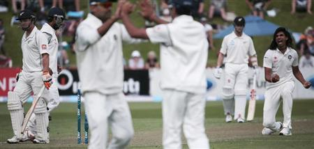 Ishant Sharma (R) celebrates his fifth wicket against New Zealand's BJ Watling (L) during day one of the second international test cricket match at the Basin Reserve in Wellington, February 14, 2014. REUTERS/Anthony Phelps