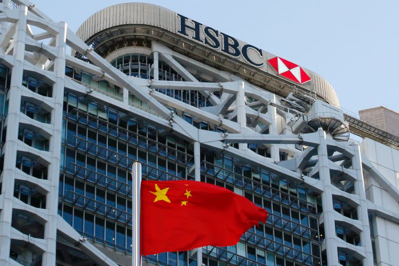 FILE PHOTO: A Chinese national flag flies in front of HSBC headquarters in Hong Kong