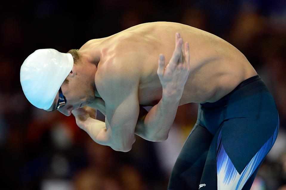<b>Michael Phelps</b><br> Michael Phelps performs his famous three arm swings on the starting block as part of his pre-race ritual. (Photo by Jamie Squire/Getty Images)