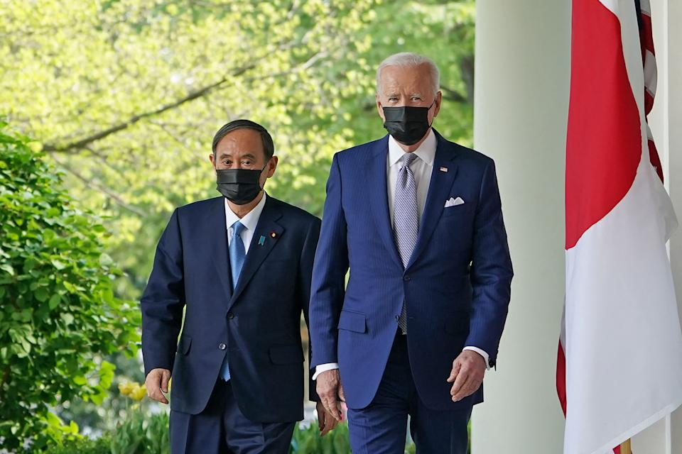 US President Joe Biden and Japan's Prime Minister Yoshihide Suga walk through the Colonnade to take part in a joint press conference in the Rose Garden of the White House in Washington, DC on April 16, 2021. (Photo by MANDEL NGAN / AFP) (Photo by MANDEL NGAN/AFP via Getty Images)