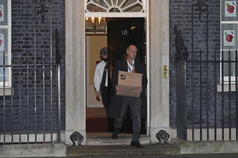 Britain's Prime Minister Boris Johnson's top aide Dominic Cummings leaves 10 Downing Street with a box, in London, Friday, Nov. 13, 2020. Late Wednesday, Lee Cain announced he was quitting as director of communications, a move that has sparked speculation that Dominic Cummings, Johnson's top adviser, could soon leave, further weakening the pro-Brexit camp. Both Cain and Cummings worked together on the 2016 Brexit referendum campaign that was largely fronted by Johnson. (Yui Mok/PA via AP)