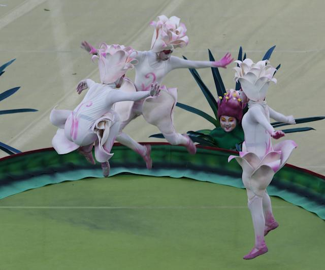 Performers jump on a trampolin during the 2014 World Cup opening ceremony at the Corinthians arena in Sao Paulo June 12, 2014. REUTERS/Paulo Whitaker (BRAZIL - Tags: SOCCER SPORT WORLD CUP)