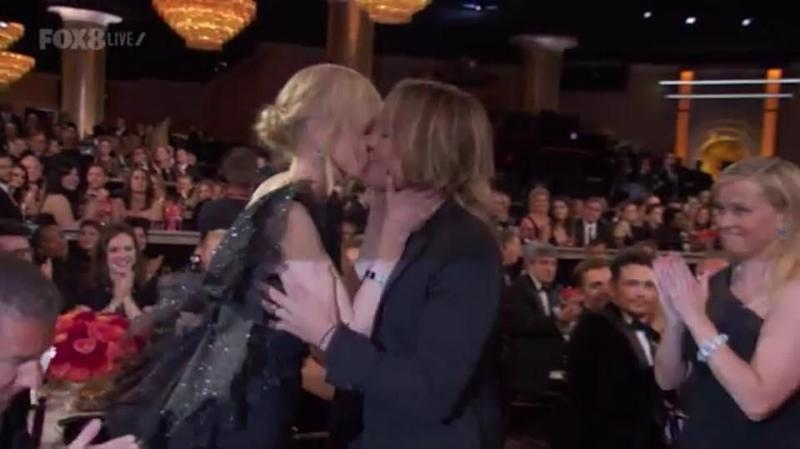 Nicole Kidman was sure to go straight in for a kiss with hubby Keith. Source: NBC