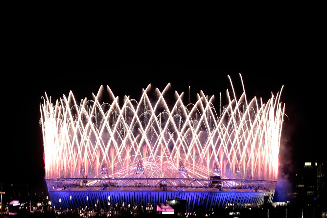 LONDON, ENGLAND - JULY 27:  Fireworks go off over the Olympic Stadium during the Opening Ceremony of the London 2012 Olympic Games at the Olympic Stadium on July 27, 2012 in London, England.  (Photo by Adam Pretty/Getty Images)