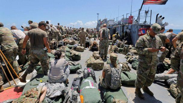 PHOTO: The deck of a U.S. Navy landing craft is crowded with Army soldiers and their belongings as they are evacuated in advance of Hurricane Maria, off St. Thomas shore, U.S. Virgin Islands, Sept. 17, 2017. (Jonathan Drake/Reuters)