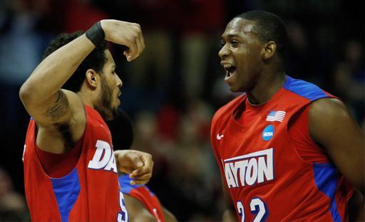Dayton's forward Devin Oliver (5) and Kendall Pollard (22) reacts to play against Stanford during the first half in a regional semifinal game at the NCAA college basketball tournament, Thursday, March 27, 2014, in Memphis, Tenn. (AP Photo/John Bazemore)