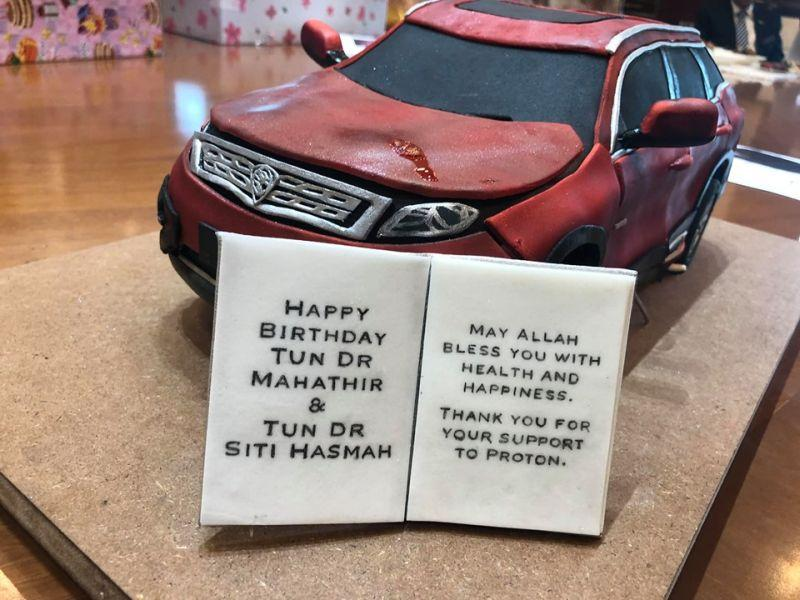 Dr Mahathir's aide Ikmal Mohamad had earlier shared a photo of a birthday cake in the form of Proton's X70 on Facebook.