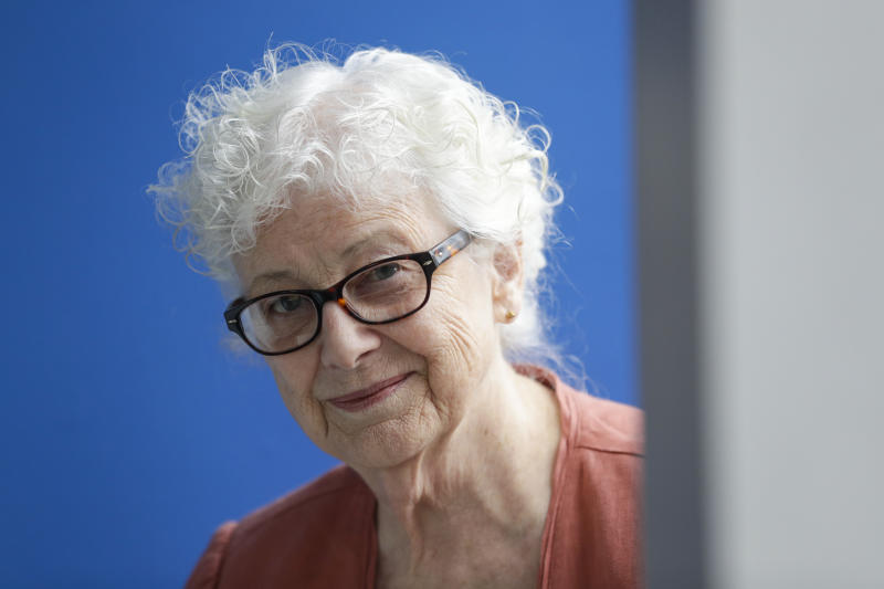 Anne Montgomery, mother of Democratic presidential candidate South Bend Mayor Pete Buttigieg, poses in his campaign office in South Bend, Ind., Wednesday, Sept. 25, 2019. (AP Photo/Michael Conroy)