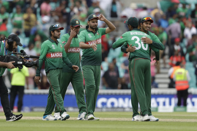 Bangladesh's captain Mashrafe Mortaza, centre, celebrates with his teammates as they walk off after winning by 21 runs in the Cricket World Cup match between South Africa and Bangladesh at the Oval in London, Sunday, June 2, 2019. (AP Photo/Matt Dunham)