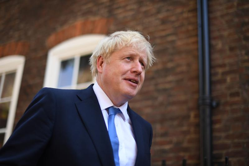 Newly elected leader of the Conservative party Boris Johnson leaves his office in Westminster, London, after it was announced he had won the leadership ballot and will become the next Prime Minister.