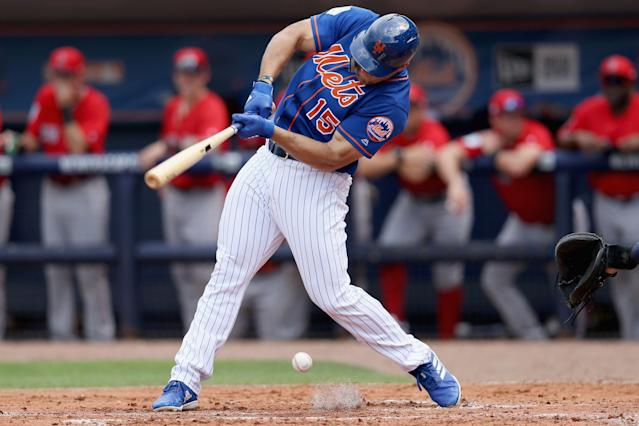 Tim Tebow's second-inning groundout prompted input by Jose Canseco. (Photo by Dylan Buell/Getty Images)