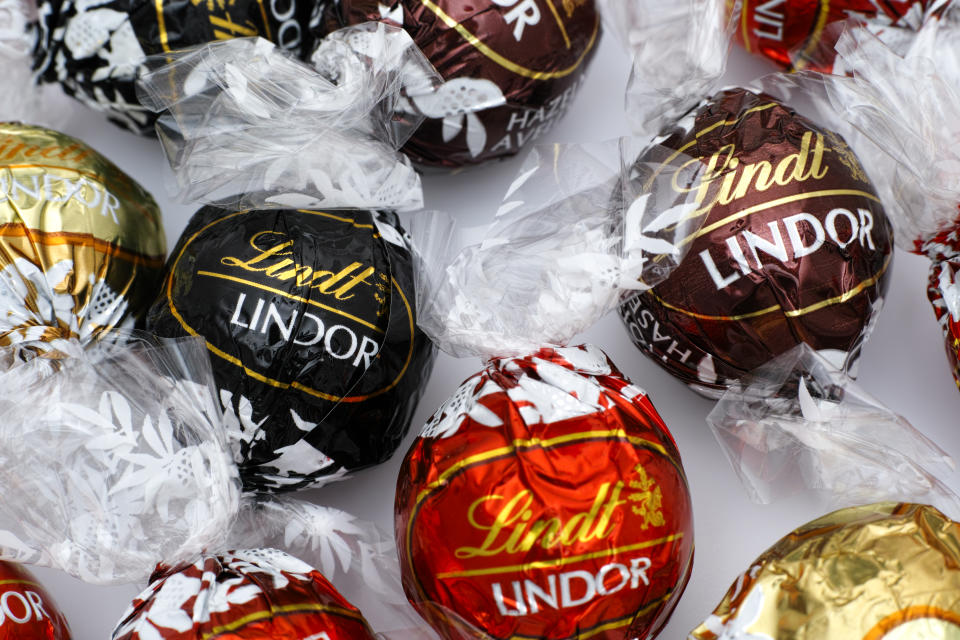 Tambov, Russian Federation - March 08, 2015: Lindt Lindor chocolate truffles on white background. Lindor assorted balls: the Lindt milk, dark and white chocolate candies. Studio shot.