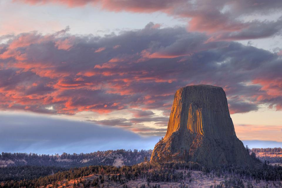 """Devils Tower, a gargantuan geological structure and an American national monument, rises 1,267 feet above the Belle Fourche River and plains in northeastern <a href=""""https://www.cntraveler.com/story/is-wyoming-the-most-feminist-state-ever?mbid=synd_yahoo_rss"""" rel=""""nofollow noopener"""" target=""""_blank"""" data-ylk=""""slk:Wyoming"""" class=""""link rapid-noclick-resp"""">Wyoming</a>. It's a world-renowned <a href=""""https://www.cntraveler.com/story/how-the-climbing-community-became-an-inclusive-space-for-women?mbid=synd_yahoo_rss"""" rel=""""nofollow noopener"""" target=""""_blank"""" data-ylk=""""slk:climbing destination"""" class=""""link rapid-noclick-resp"""">climbing destination</a>—but it's also a sacred site for more than 20 Native American tribes and indigenous people, according to the National Park Service. The Crow call the tower """"Bear Lodge"""" and have been known to fast and worship there, even building small stone houses for dream quests. The formation has also been the site of one of the Lakota's famous battles, purification rites, and the tribe's sacred Sun Dance. The Arapahoe, Cheyenne, Kiowa, and Shoshone have documented ties, too, and many ceremonies and prayer offerings continue to take place at the tower today. You may see religious paraphernalia such as prayer cloths at the site, but the NPS urges tourists to be respectful and avoid disturbing."""