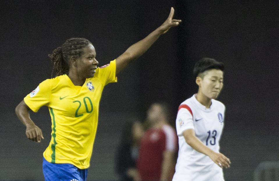 South Korea's Kwon Hahnul (13) walks by as Brazil's Formiga (20) celebrates after scoring during the first half of a FIFA Women's World Cup soccer match Tuesday, June 9, 2015, in Montreal, Canada. (Graham Hughes/The Canadian Press via AP)