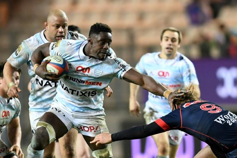 Racing Metro 92 flanker Yannick Nyanga (C-L) attempts to evade tackle by Grenoble's scrum-half Charl Mcleod during their French Top 14 rugby union match, at the Stade des Alpes in Grenoble, on March 4, 2017