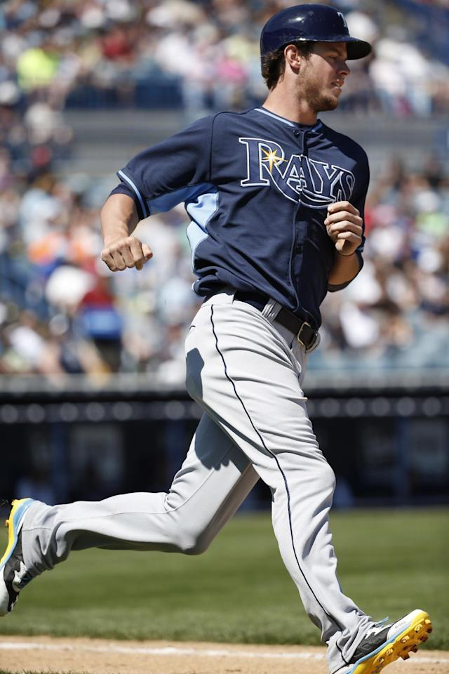 Tampa Bay Rays' Wil Myers runs on his fourth-inning single during a spring exhibition baseball game against the New York Yankees in Tampa, Fla., Sunday, March 9, 2014. (AP Photo/Kathy Willens)