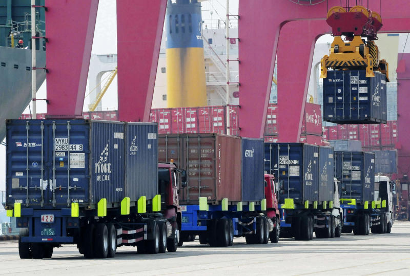 A shipping container is craned to a containership at a port in Qingdao in east China's Shandong province Wednesday, April 10, 2013. China reported higher import growth in March on Wednesday in a possible positive sign for its economic recovery but analysts said doubts about the accuracy of Beijing's data made it hard to draw conclusions. (AP Photo) CHINA OUT