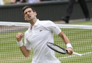 Serbia's Novak Djokovic celebrates after defeating Canada's Denis Shapovalov during the men's singles semifinals match on day eleven of the Wimbledon Tennis Championships in London, Friday, July 9, 2021. (AP Photo/Kirsty Wigglesworth)