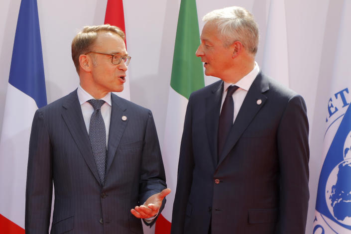 French Finance Minister Bruno Le Maire, right, welcomes German Bundesbank President Jens Weidmann at the G-7 Finance Wednesday July 17, 2019 in Chantilly, north of Paris. The Group of Seven rich democracies' top finance officials gathered Wednesday at a chateau near Paris in search of common ground on the threats posed by digital currencies. (AP Photo/Michel Euler)