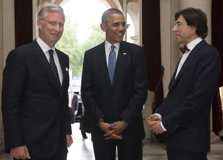 U.S. President Barack Obama attends a meeting with Belgian King Philippe (L) and Belgium's Prime Minister Elio Di Rupo (R) at the Royal Palace ahead of a G7 summit in Brussels June 4, 2014. REUTERS/Benoit Doppagne/Chancellerie du Premier- Kanselarij Van de Premier/Pool