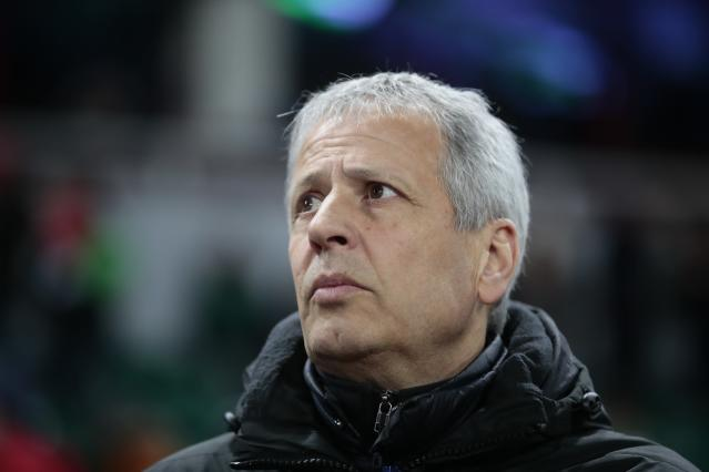 FILE - In this Feb. 22, 2018 file photo Nice's head coach Lucien Favre watches the Europa League Round of 32 second leg soccer match between Lokomotiv Moscow and Nice in Moscow, Russia. Borussia Dortmund has signed Lucien Favre as coach from French side Nice. The Bundesliga club says Tuesday, May 22, 2018 the 60-year-old Favre, who previously coached league rivals Borussia Moenchengladbach and Hertha Berlin, has signed a deal through June 2020. (AP Photo/Denis Tyrin.file)