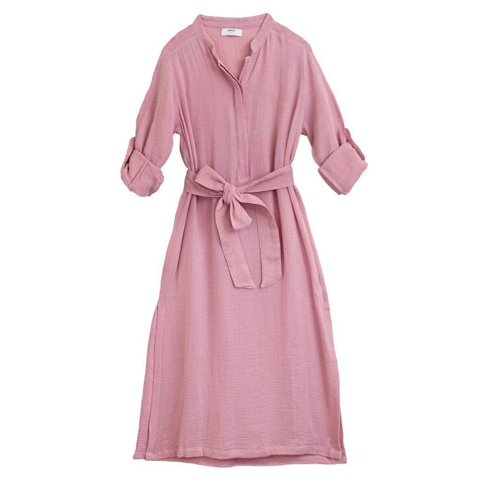 """<p>mikoh.com</p><p><strong>$143.00</strong></p><p><a href=""""https://shop.mikoh.com/products/r1-oku-tunic?variant=32910410645561"""" rel=""""nofollow noopener"""" target=""""_blank"""" data-ylk=""""slk:Shop Now"""" class=""""link rapid-noclick-resp"""">Shop Now</a></p><p>Mikoh knows a thing or two about dressing for the beach. This tunic has the perfect amount of sophisticated details, from the notch collar to the rolled sleeves—if you want to look polished add <a href=""""https://www.townandcountrymag.com/style/fashion-trends/a36110815/esparille-shoe-history-review/"""" rel=""""nofollow noopener"""" target=""""_blank"""" data-ylk=""""slk:espadrilles"""" class=""""link rapid-noclick-resp"""">espadrilles</a> and an <a href=""""https://www.townandcountrymag.com/style/fashion-trends/g27226558/best-swimsuit-brands/"""" rel=""""nofollow noopener"""" target=""""_blank"""" data-ylk=""""slk:Eres maillot"""" class=""""link rapid-noclick-resp"""">Eres maillot</a>. It's a recipe that simply will not fail.</p>"""