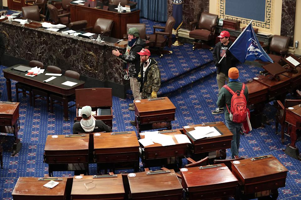 Protesters enter the Senate Chamber on January 06, 2021 in Washington, DC. (Photo by Win McNamee/Getty Images)