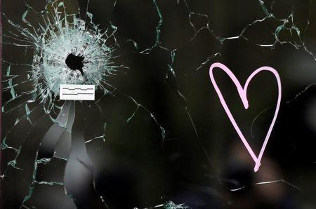 A bullet impact is seen in the window near the Le Carillon restaurant, one of the attack sites in Paris, November 16, 2015. REUTERS/Jacky Naegelen