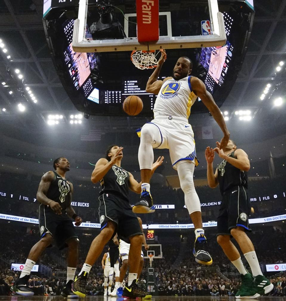 The Warriors' Andre Iguodala dunks against the Milwaukee Bucks on Friday night in Milwaukee. (AP Photo/Morry Gash)