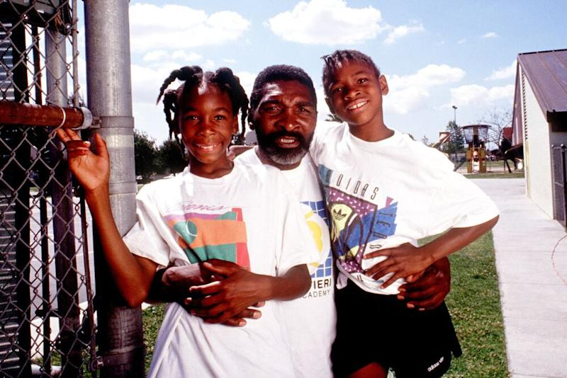 Richard Williams, center, with his daughters Venus, left, and Serena 1991 in Compton, CA | Paul Harris/Online USA/Getty