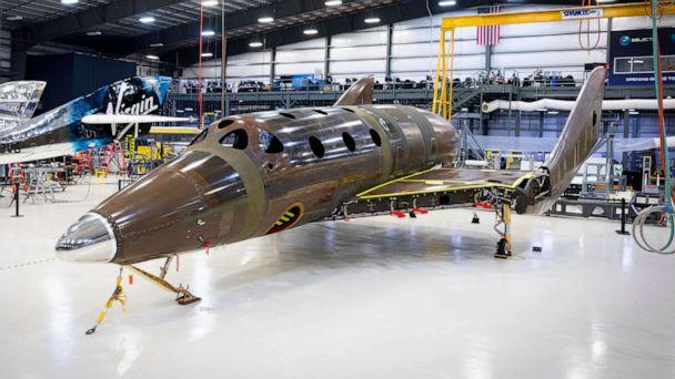 PHOTO: This photo released by Virgin Galactic Wednesday, Jan. 8, 2020, shows Virgin Galactic's next passenger spaceship standing on its landing gear in a hangar at the company's Mojave Air & Space Port in Mojave, Calif. (Thomas Storesund/Virgin Galactic via AP)