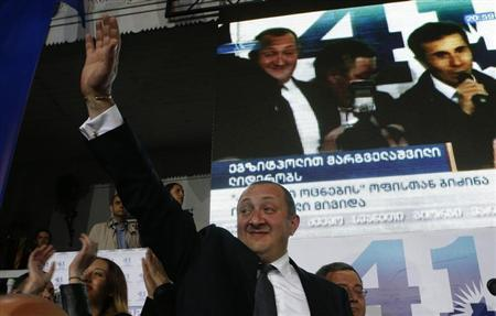Presidential candidate Margvelashvili greets supporters as he celebrates his victory in Sunday's presidential election at the Georgian Dream coalition's headquarters in Tbilisi