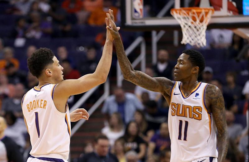 1fb0b5d7dccb5 Phoenix Suns guard Devin Booker (1) celebrates his dunk against the  Washington Wizards with