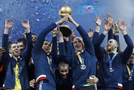 Men's Handball - France v Norway - 2017 Men's World Championship, Final - AccorHotels Arena, Paris, France - 29/01/17 - France's team celebrates gold medal on the podium .   REUTERS/Benoit Tessier