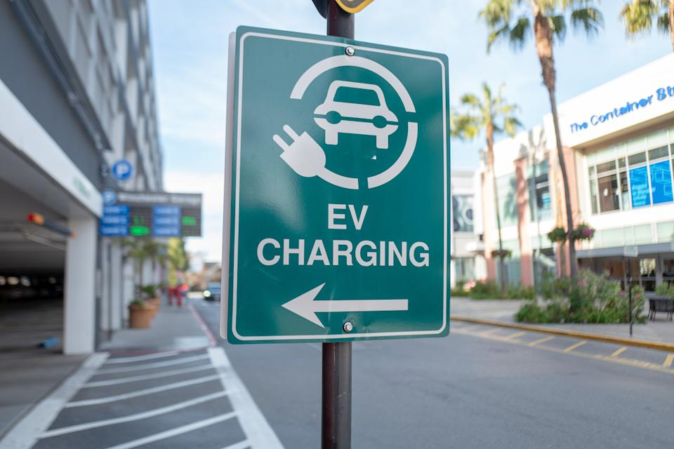 Close-up of sign for electric vehicle charging station on Santana Row in the Silicon Valley, San Jose, California, January 3, 2020. (Smith Collection/Gado/Getty Images)