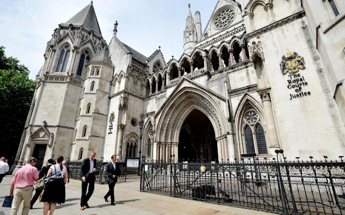 The Royal Courts of Justice in central London - PA