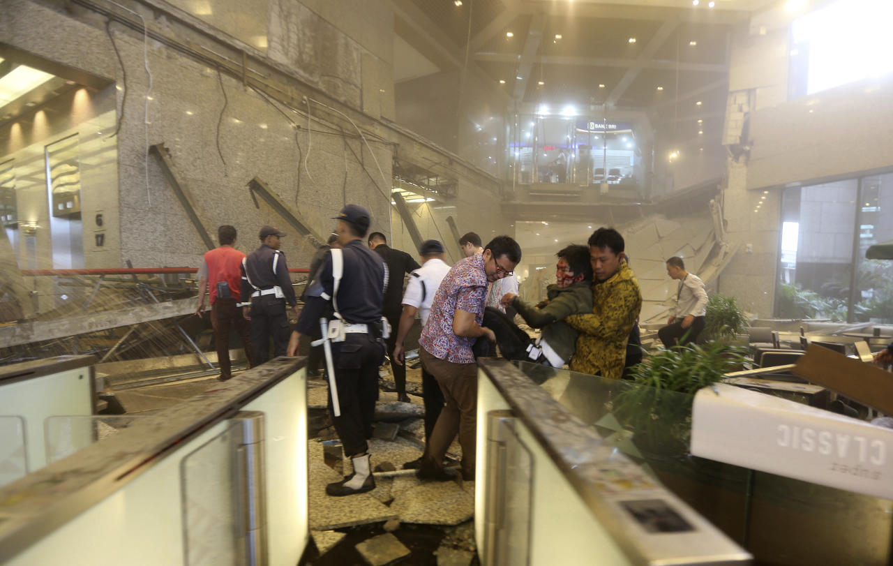 <p>An injured man is carried out of the Jakarta Stock Exchange tower after a floor collapse in Jakarta, Indonesia, Jan. 15, 2018. A mezzanine floor inside the tower collapsed on Monday, injuring dozens of people and forcing a chaotic evacuation. (Photo: Tatan Syuflana/AP) </p>