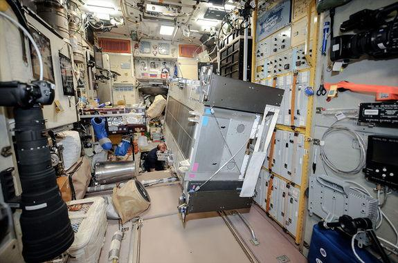 The International Space Station's first treadmill, referred to as the Treadmill Vibration Isolation System, or TVIS, is seen floating inside the orbiting outpost in May 2013 as it was being prepared for its disposal on June 11.