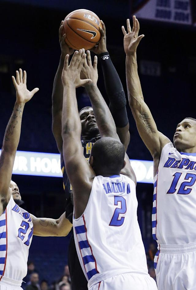 Southern Mississippi guard Chip Armelin, back, goes up for a shot against DePaul forward Jamee Crockett (21), center Tommy Hamilton IV (2) and forward Cleveland Melvin (12) during the first half of an NCAA college basketball game in Rosemont, Ill., Wednesday, Nov. 13, 2013. (AP Photo/Nam Y. Huh)
