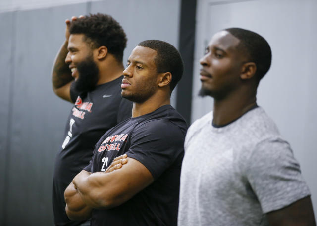 Georgia running back Nick Chubb, center, watches on alongside offensive lineman Isaiah Wynn and running back Sony Michel, right, during Georgia Pro Day, Wednesday, March 21, 2018, in Athens. Pro Day is intended to showcase talent to NFL scouts for the upcoming draft. (AP Photo/Todd Kirkland)