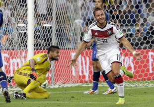 Germany's Mario Goetze celebrates after scoring the opening goal during the World Cup final soccer match between Germany and Argentina at the Maracana Stadium in Rio de Janeiro, Brazil, Sunday, July 13, 2014. Germany won 1-0 to win the World Cup. (AP Photo/Victor R. Caivano)