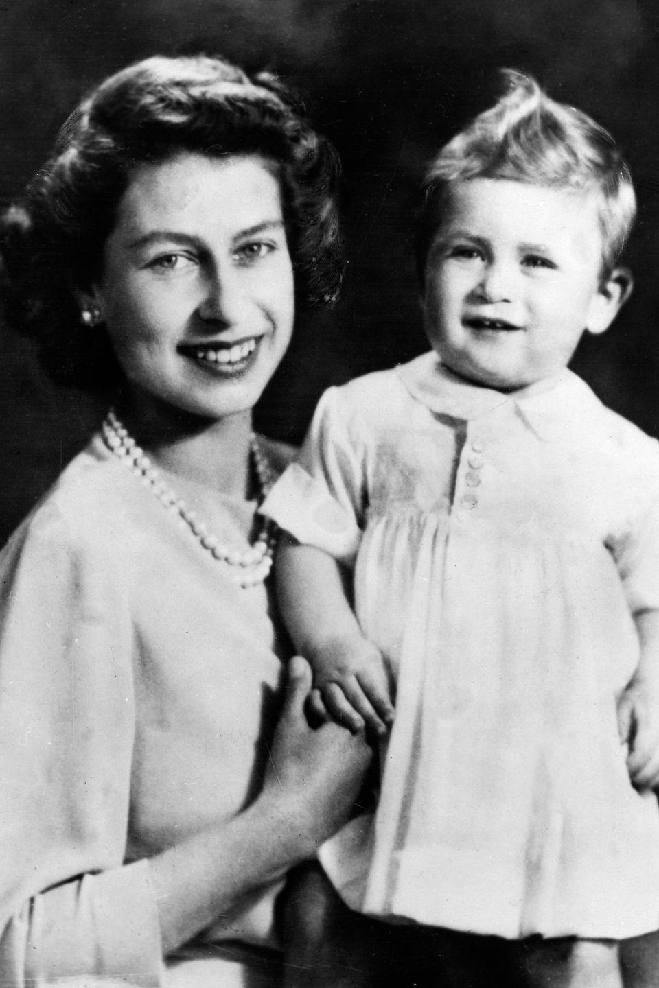 <p>The queen looked thrilled while she posed with her son Prince Charles.</p>