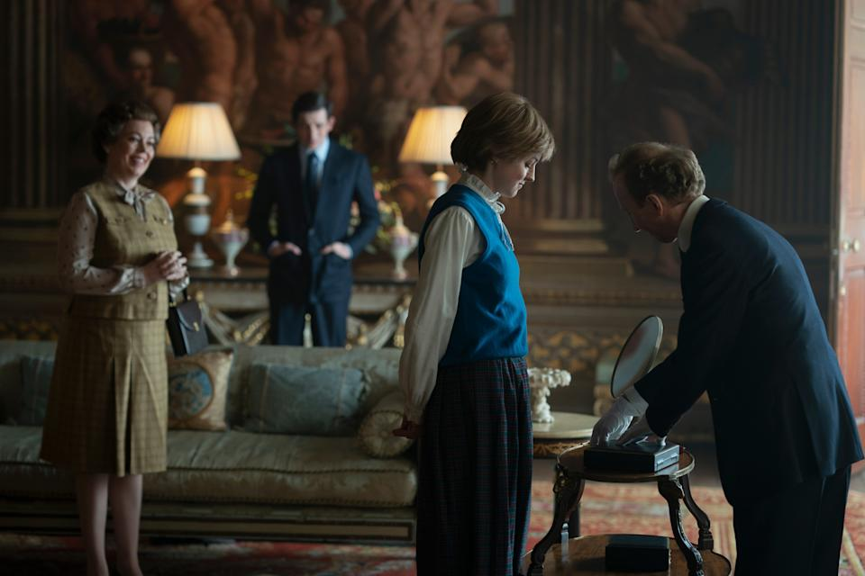 """Queen Elizabeth II (Olivia Coleman) and Prince Charles (Josh O'Connor) as Princess Diana (Emma Corrin) picks her famous engagement ring in Netflix's """"The Crown."""""""
