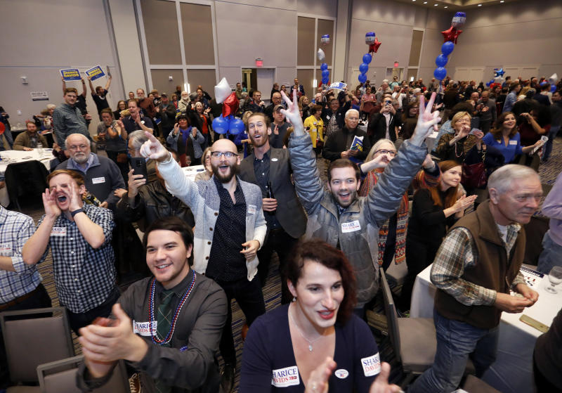 Supporters of Sharice Davids celebrate her victory over the Republican incumbent, Kevin Yoder, in their Kansas House race. (ASSOCIATED PRESS)