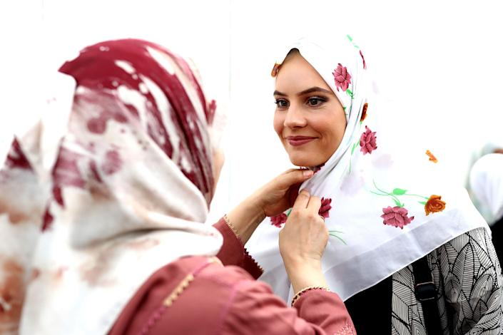 A muslim woman gives away a free hijab to guests attending the Ponsonby Masjid Mosque during an open service to all religions on March 22, 2019 in Auckland, New Zealand.