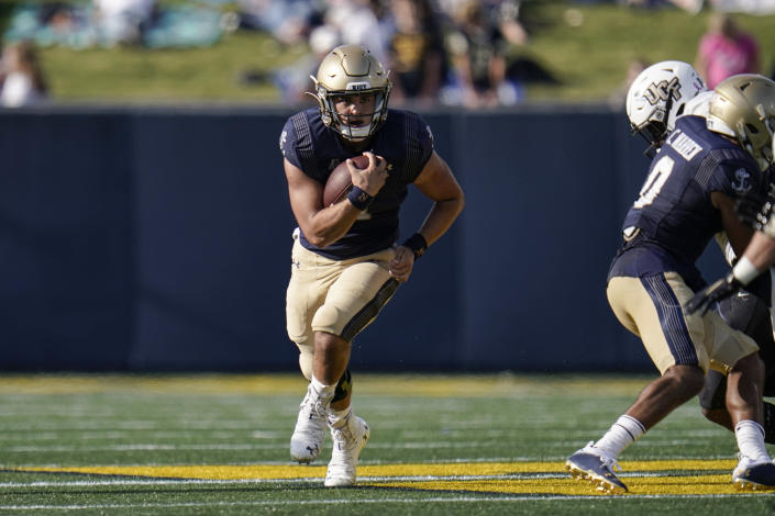 Navy quarterback Tai Lavatai runs with the ball against UCF during the first half of an NCAA college football game, Saturday, Oct. 2, 2021, in Annapolis, Md. (AP Photo/Julio Cortez)