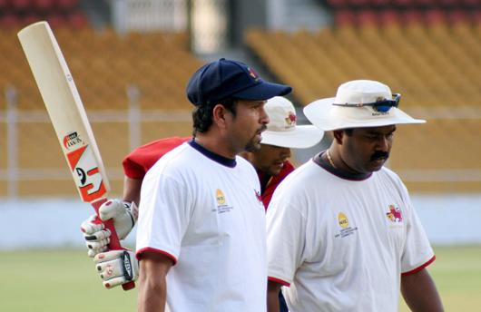 """Sachin Tendulkar had long conversations with the coach Praveen Amre, egging him and his team to perform well, putting behind the lackadaisical approach against Saurashtra last week. Amre said: """"Sachin came and entire morale of the team has changed for the better. He had one-on-one conversations with the players. Sachin is important for us and it is nice to see him take the initiative to talk to the players. At the end of Sachin's visit, he said that we need not worry too much and go out there and play positive cricket."""" >Getty Images</i>"""