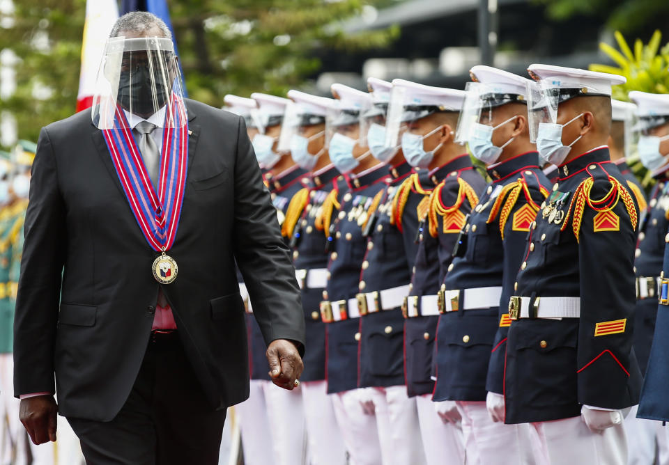 United States Defense Secretary Lloyd Austin views the military honor guard at Camp Aguinaldo military camp in Quezon City, Metro Manila, Philippines Friday, July 30, 2021. Austin is visiting Manila to hold talks with Philippine officials to boost defense ties and possibly discuss the The Visiting Forces Agreement between the US and Philippines. (Rolex dela Pena/Pool Photo via AP)