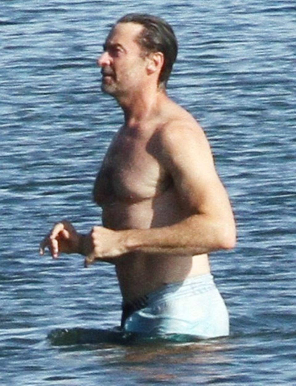 <p>Hugh Jackman goes for a swim on Monday in The Hamptons, New York, to cool off from the heat.</p>